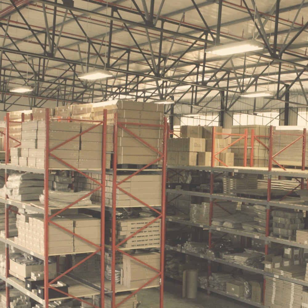 Vast Front Runner warehouse stacked with boxes of merchandise on wooden shelves